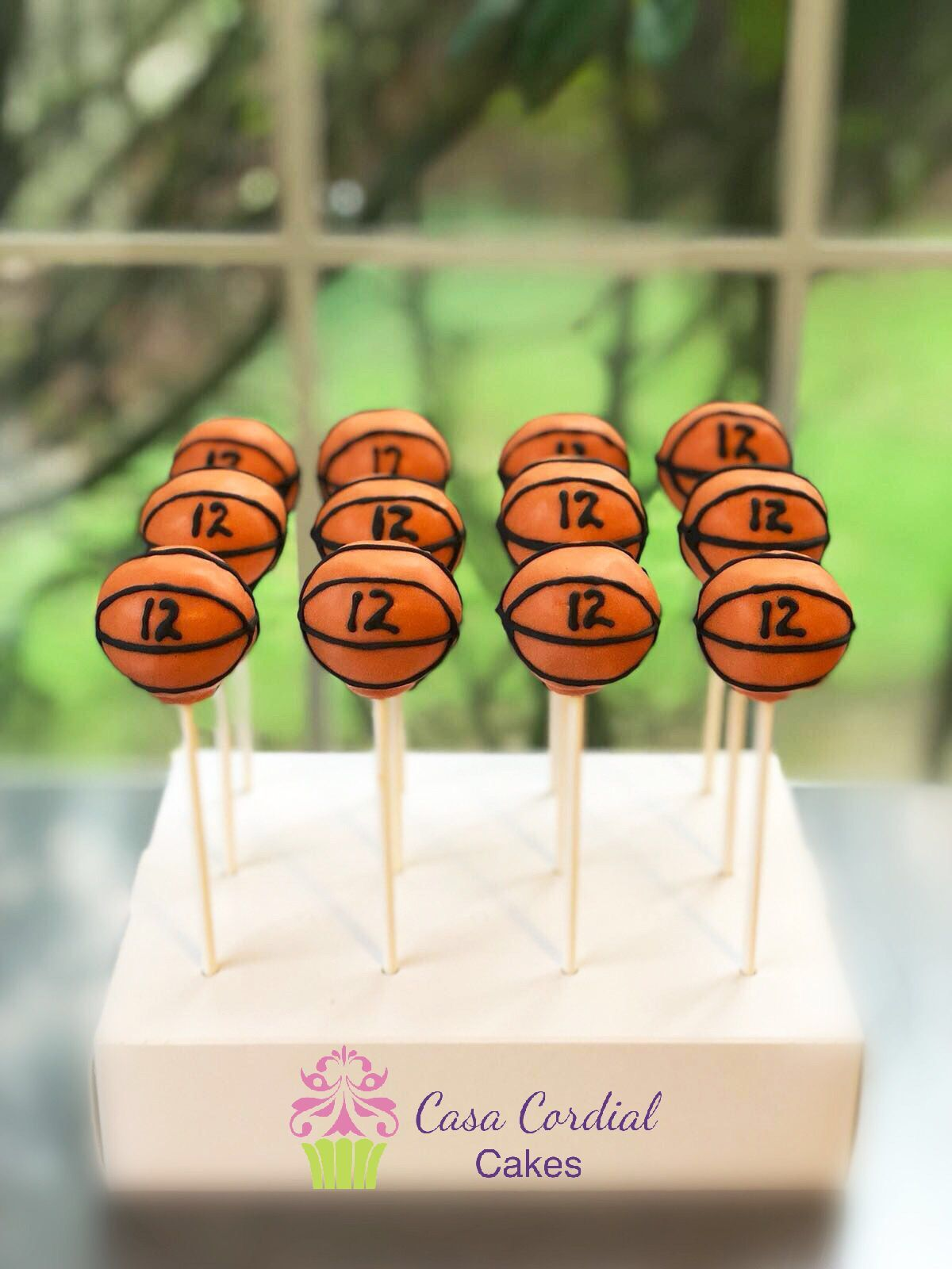 Basketball cake pops casacordialcakes basketball cake