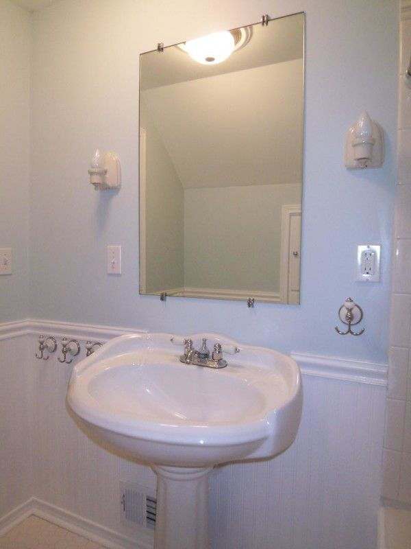 Wonderful Cottage Style Bathroom Light Fixtures Using White Ceramic Wall Sconce And Frameless Rectangular Mirror Over