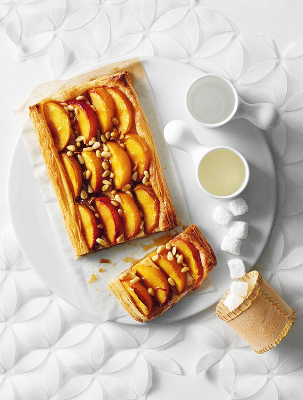 puff pastry w | peach + pine nuts + a french cream under peaches.