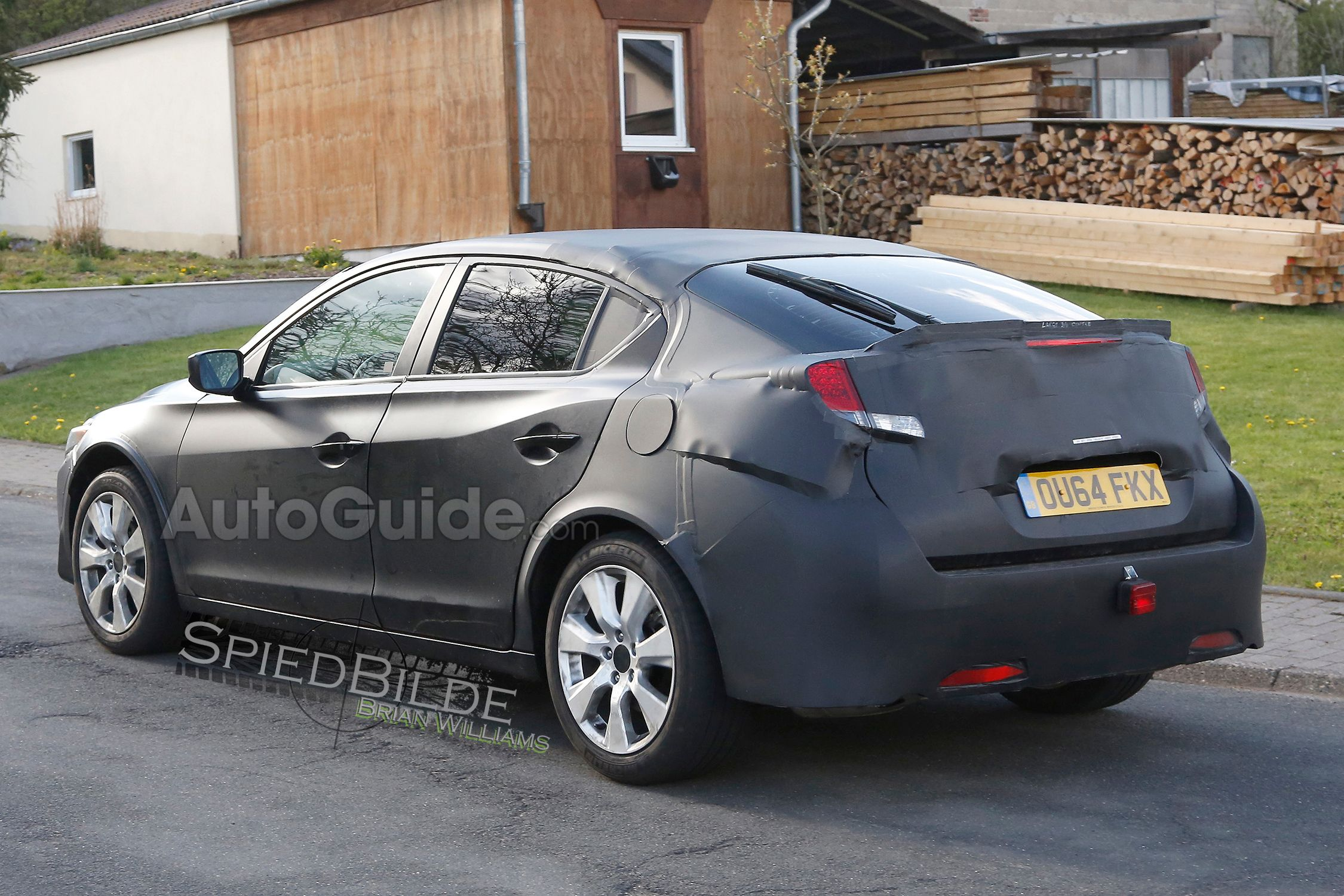 New spy photos are in showing the upcoming honda civic this honda civic hatchback mule was spotted on the streets of germany wearing british