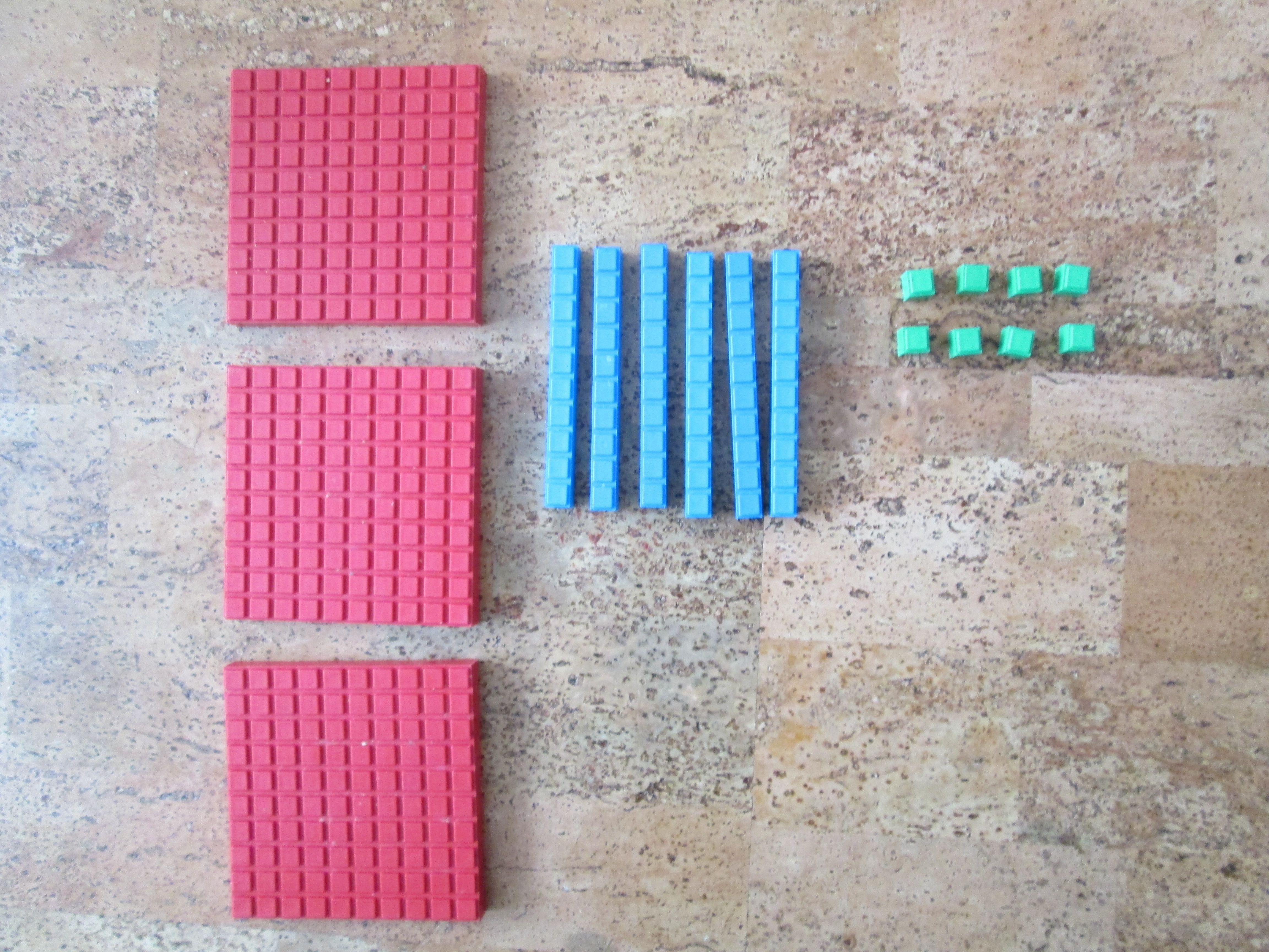 Demonstrates Using Base Ten Blocks To Teach Long Division