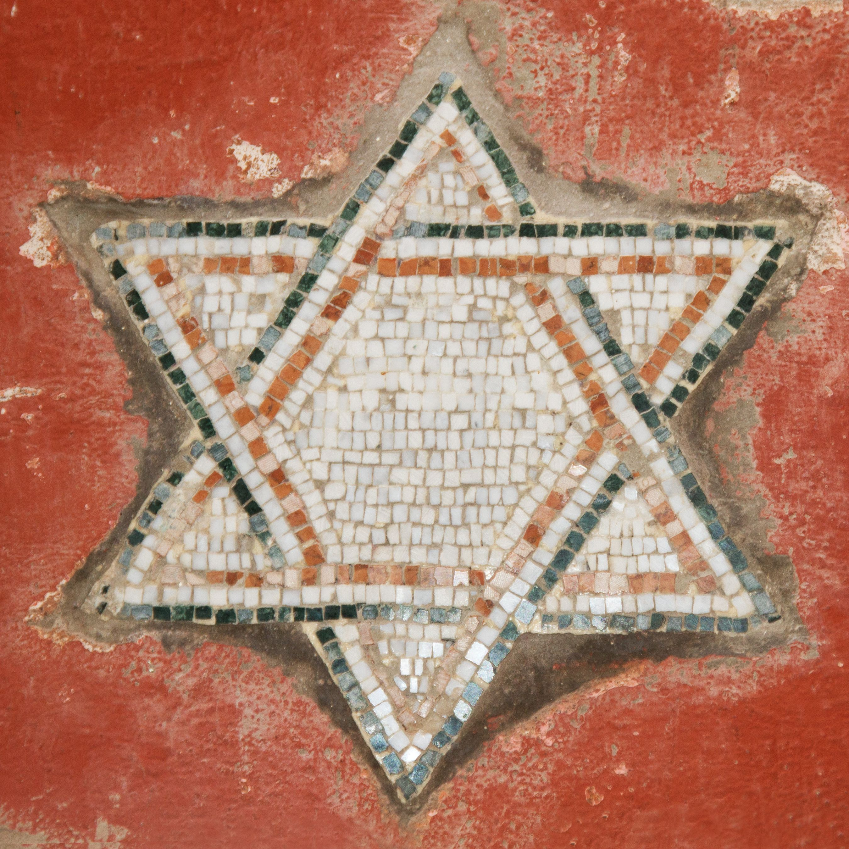 The Dodge Star And Jewish History: On A Wall In The Jewish Quarter Of Rome. The Jewish