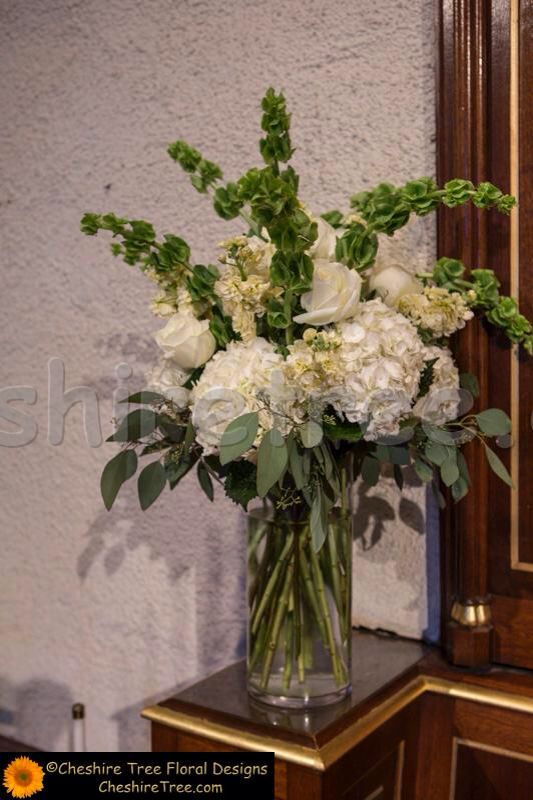 White Hydrangeas With Bells Of Ireland And Mixed Greenery Not Sure I Like The T Hydrangea Flower Arrangements Hydrangea Arrangements Large Flower Arrangements