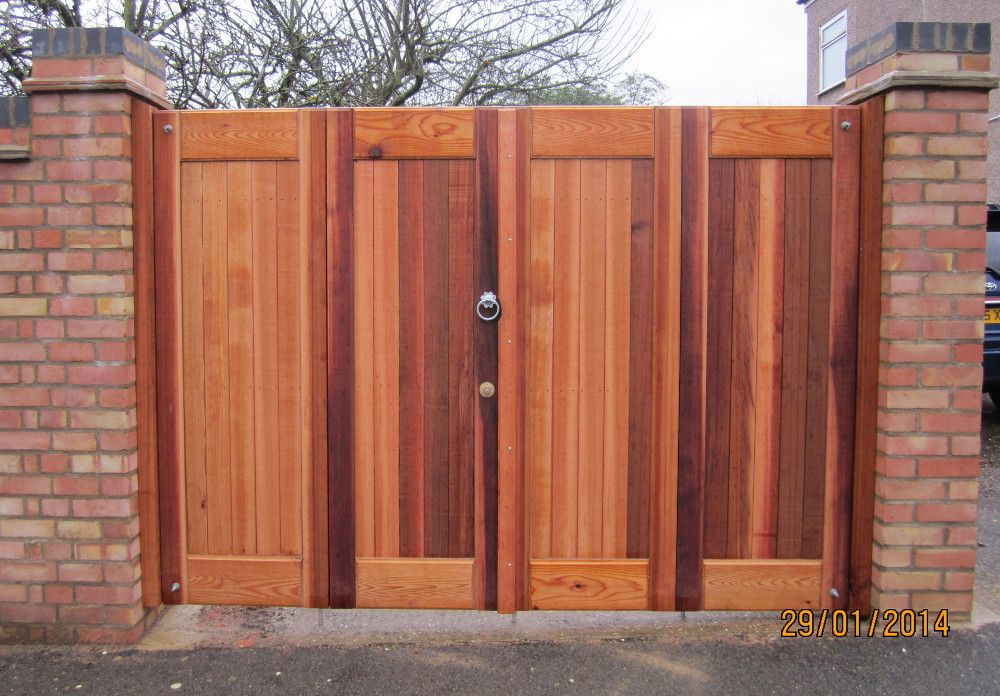 Bi fold flat top double gates redwood and siberian larch