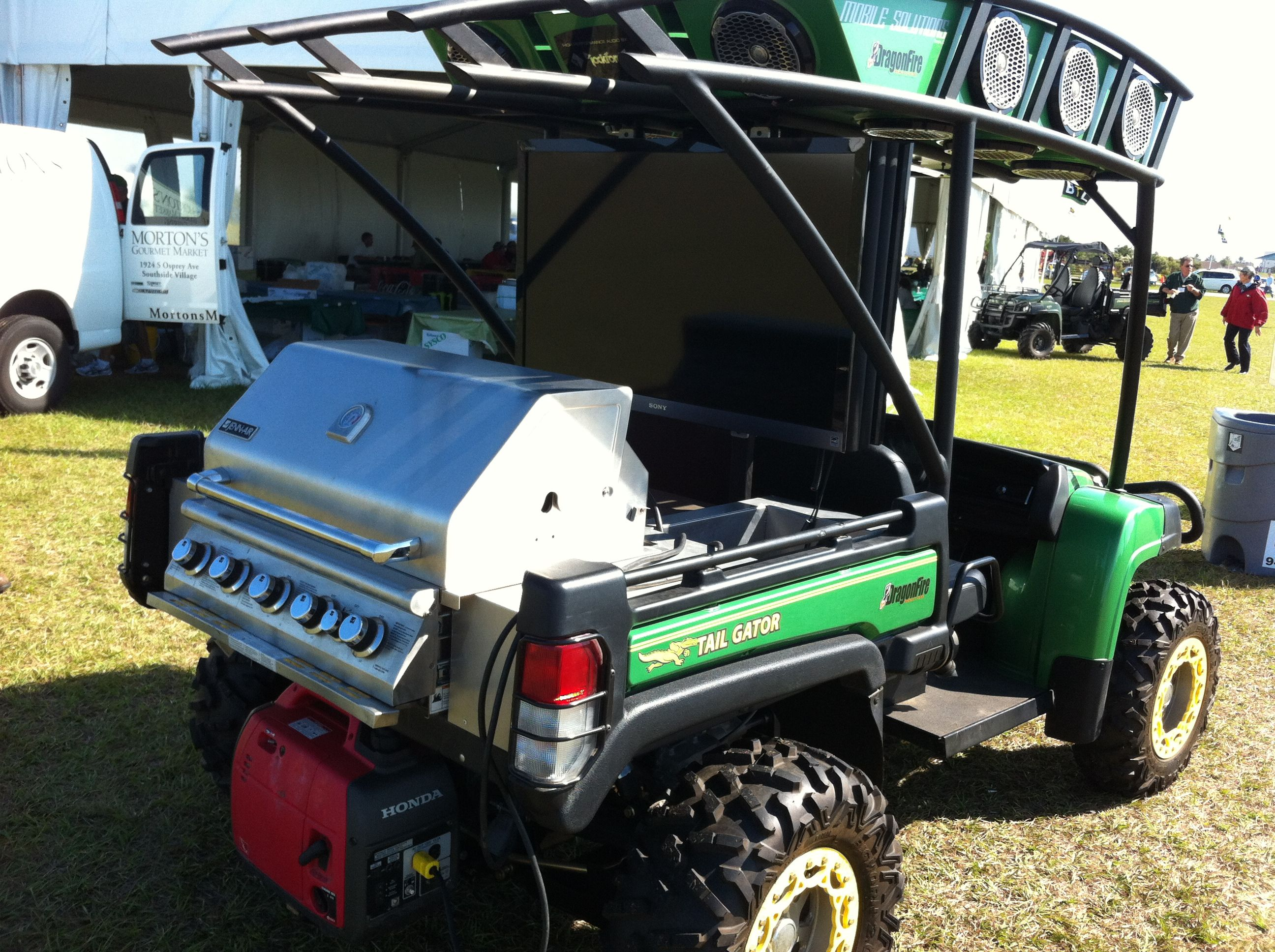 Tailgating Gator- Two plasmas, bbq, speakers all the way around and a generator to power all.