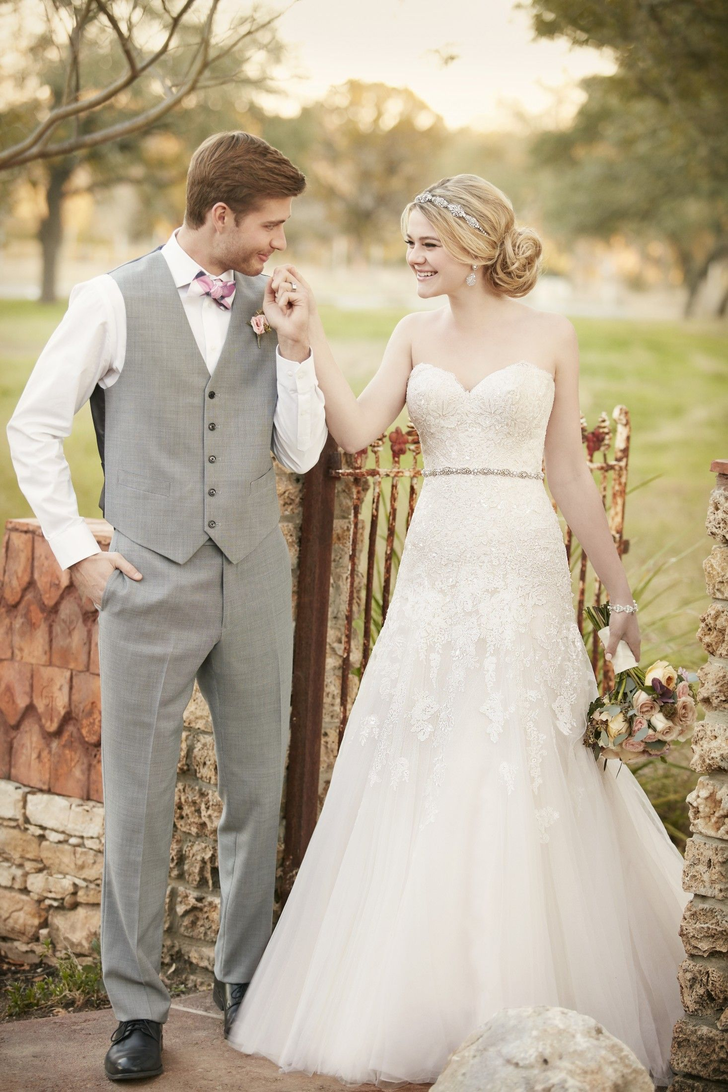 This modified designer A-line wedding gown from Essense of Australia ...