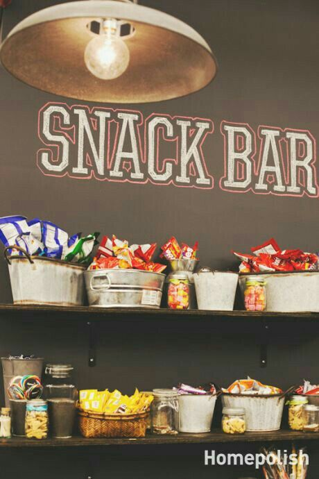 Snack bar using buckets and tins to put goodies in sitting ...