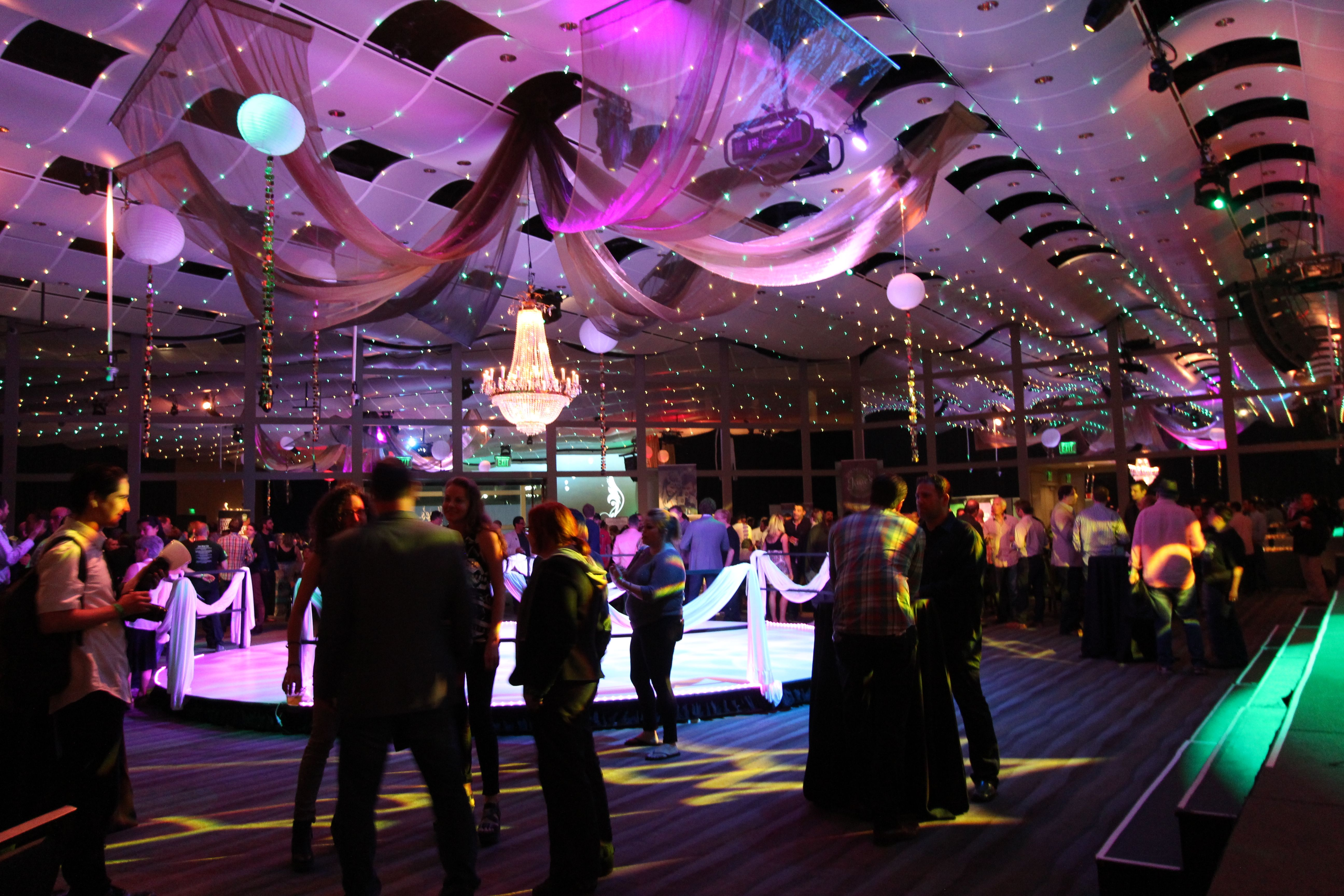 ArcView Event with a stunning round stage, draping, dramatic LED lighting and Gobos