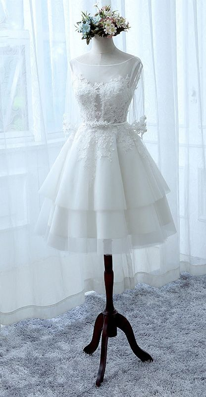 Lovely short wedding dress. With illusion half sleeves and aline ...