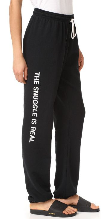 5f78262d7 the snuggle is real sweatpants by Private Party. Slouchy Private Party  sweatpants, detailed with playful 'The Snuggle is Real' lettering at one  leg.