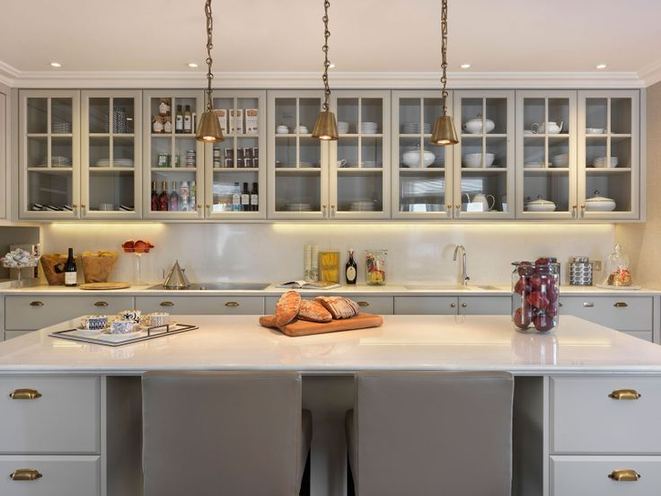 Love the glass cabinetry concept stunning kitchen with light gray cabinets accented with brass