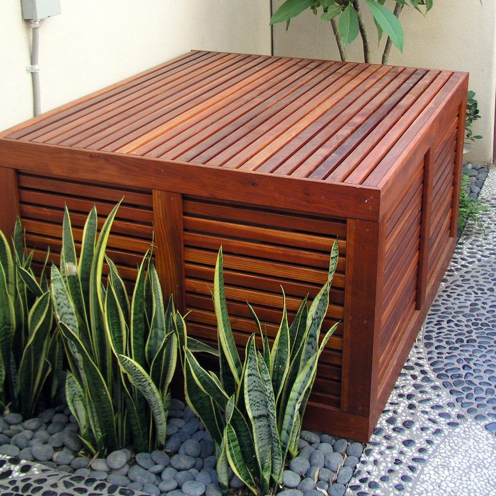 Pool equipment cover landscape contemporary with wood