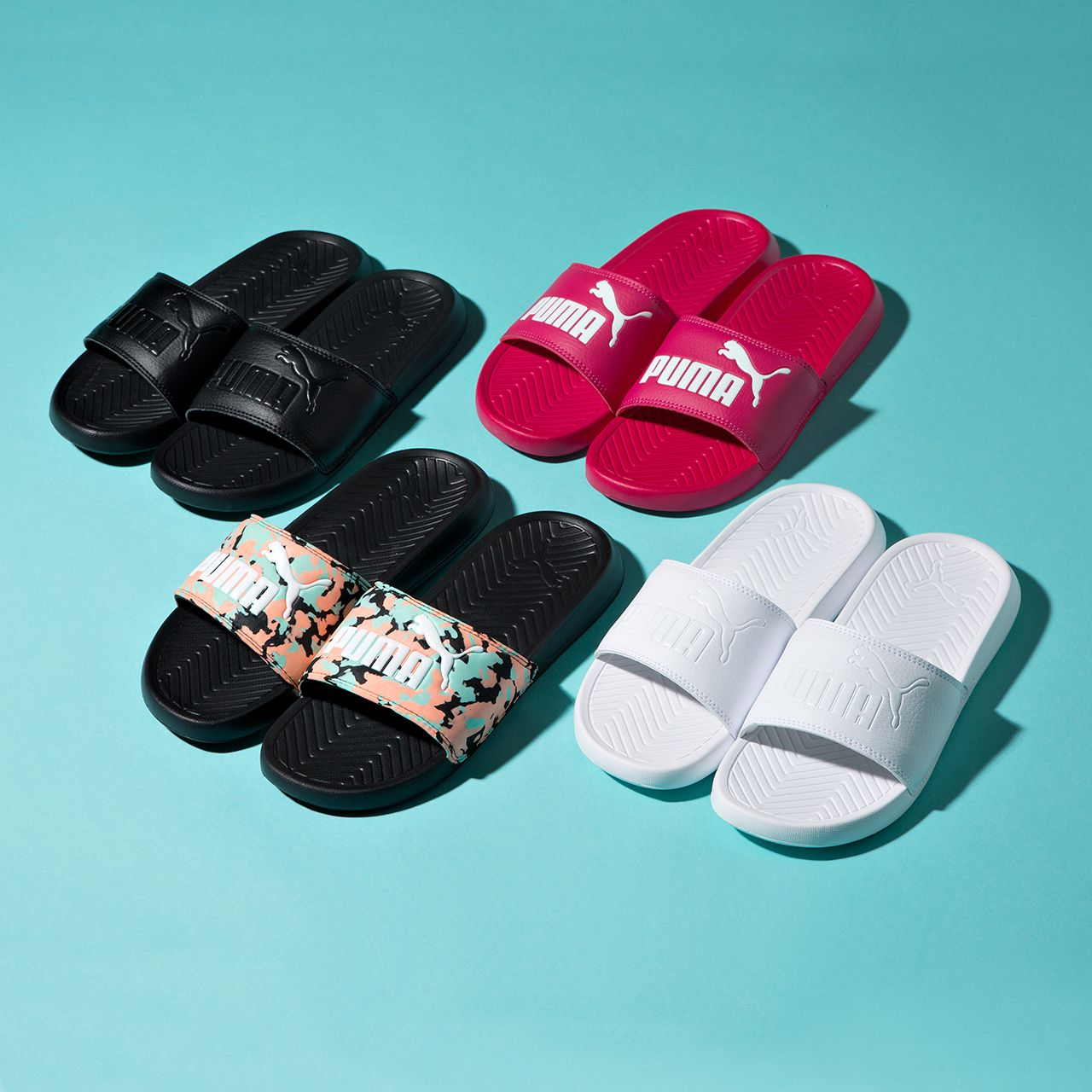 837794fb347d Prepare for the holiday season with the Puma Womens Popcat Slide Sandal.