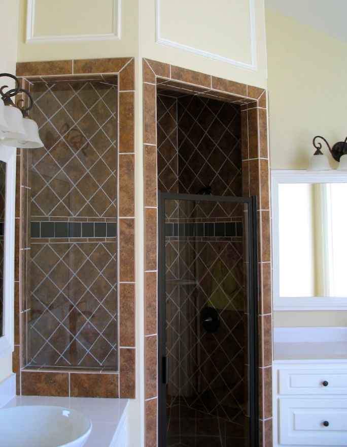 Tiled walk in Shower. Easy to clean and beautiful statement piece for your master bath!