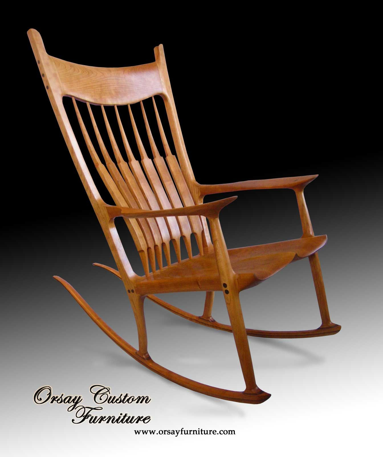 Rocking chair. Handmade of black cherry with black walnut dowels. This Maloof style sculptured
