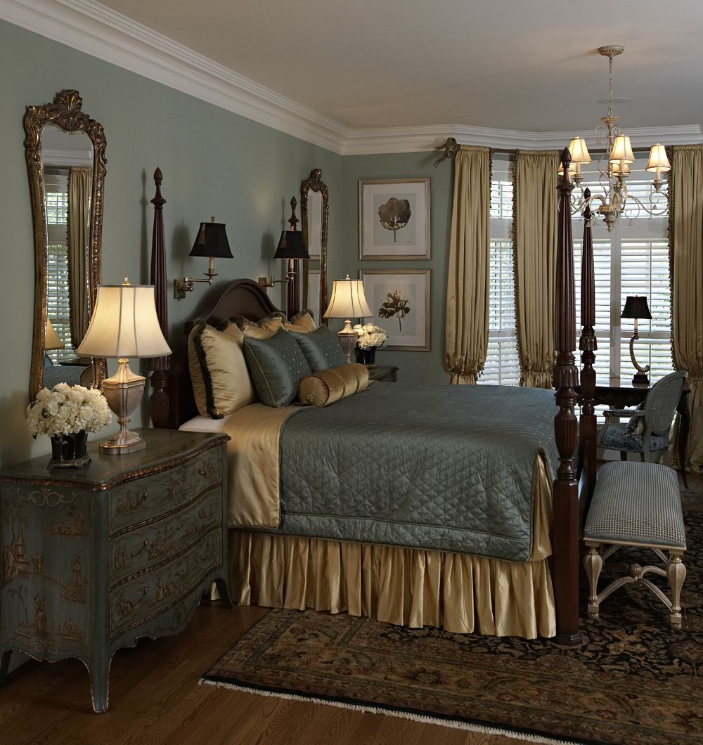 traditional elegant bedroom in soft blue and cream notice the large mirrors rug etc