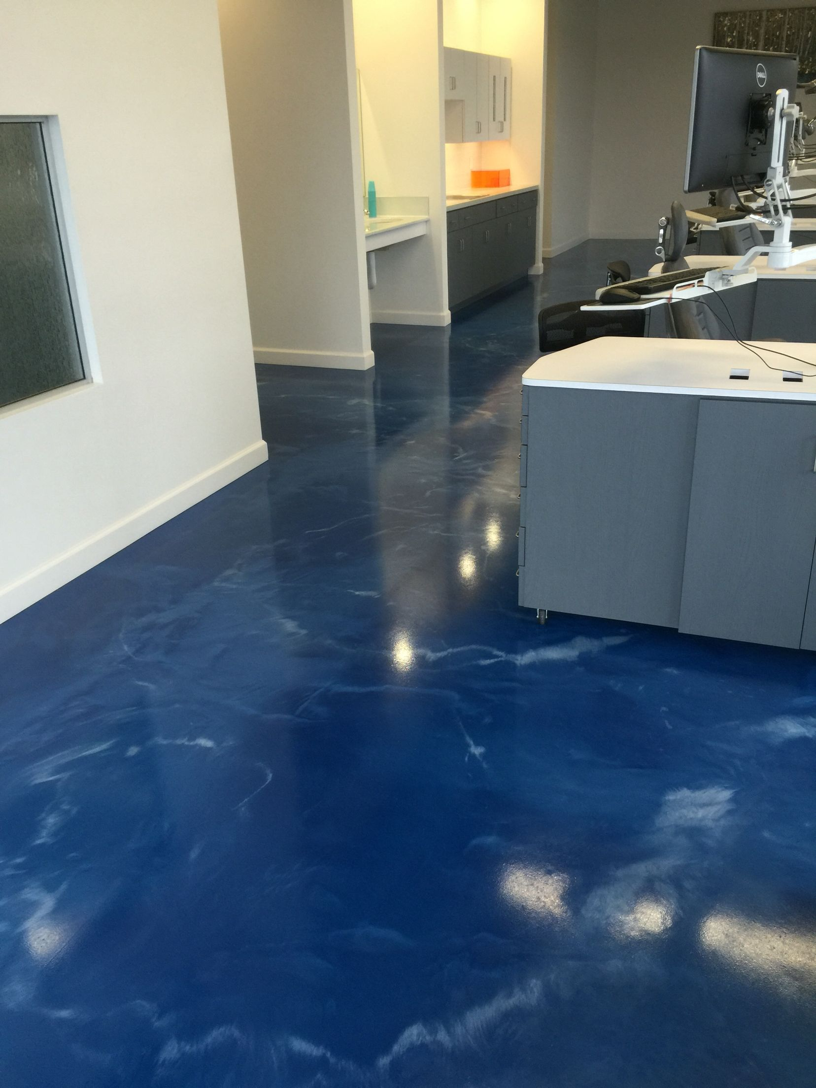 Metallic epoxy floor installed for a Dental office by