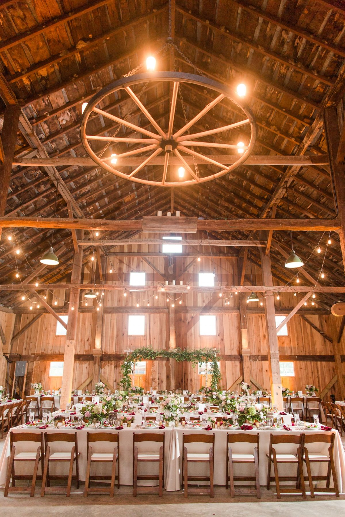 Rustic wedding reception decor idea barn venue with high for Pictures of wedding venues decorated