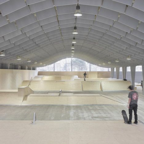 French studio Bang Architectes has converted a former peanut factory in Calais into a skateboarding park with a bright orange mesh facade (photos by Julien Lanoo).