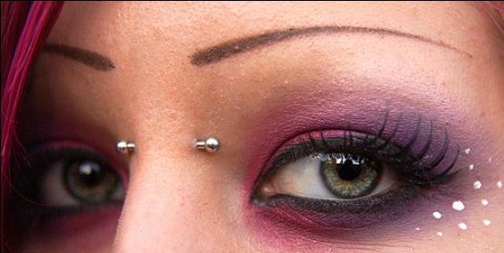 Bridge Piercing With Beautiful Colored Eyes Bridge Piercing