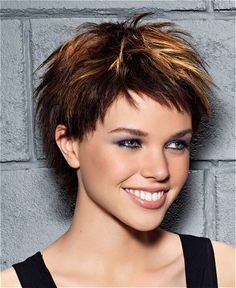 A short brown straight coloured multi-tonal streaks spikey choppy vibrant hairstyle by Coiff