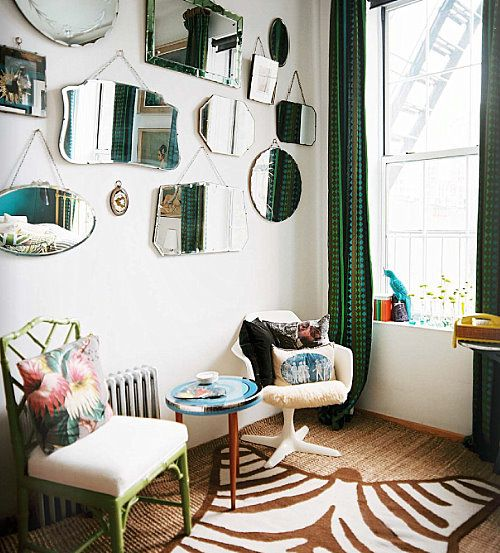 Different shaped mirrors placed on a wall creates a unique focal point.