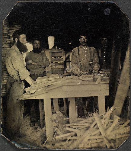 Interior of mill, showing men assembling cheese boxes / Hommes en train d'assembler des boîtes à fromage dans une usine