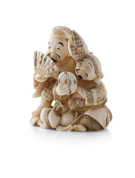 JAPANESE IVORY NETSUKE OF TWO MANZAI PERFORMERS MEIJI PERIOD depicting a man dancing with a fan and another accompanying on a drum, with a red lacquer signature panel 5cm high  Notes: Provenance: The Symington Grieve Collection of Japanese Works of Art