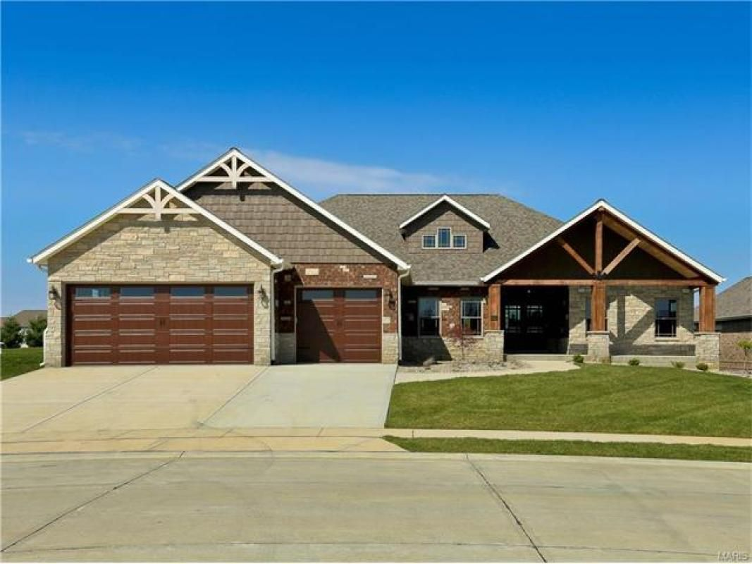"WOW! This new construction is a beauty! Approximately 4300 sq. ft of finished living space - featuring 5 bedrooms & 4 bathrooms! Covered front porch features beautiful wood ceiling and gorgeous front door!  Spacious, open  floor plan. Living room features vaulted ceiling, stone gas fireplace - opens to kitchen with faulted ceiling, 42"" maple cabinets, quartz counter tops, large kitchen island/breakfast bar and spacious walk-in pantry. Hardwood floors and beautiful crown molding throughout…"