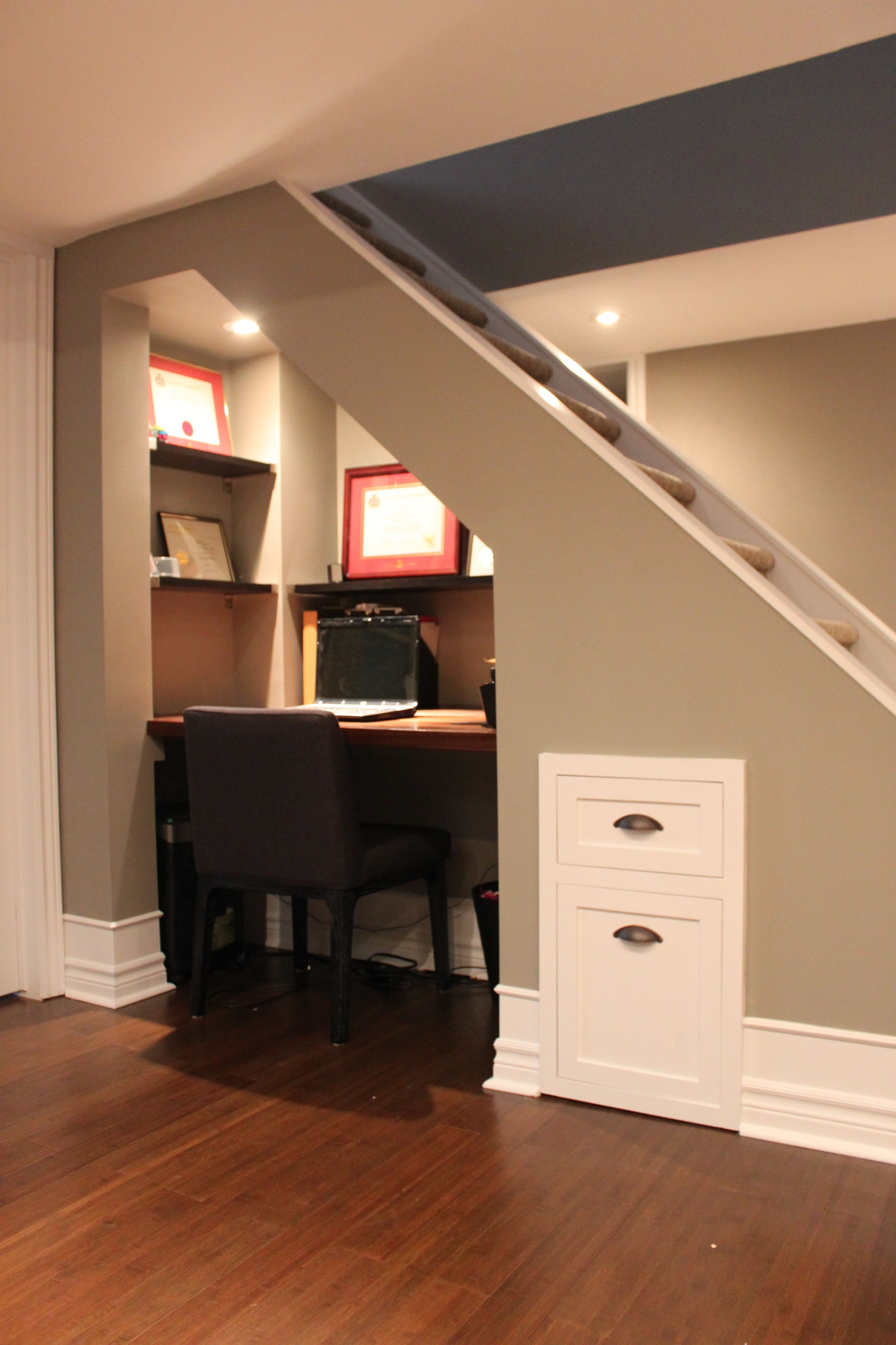 Office under the basement stairs what a great use of for Using space under stairs