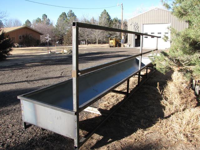 Fence line feed bunks | Livestock | Show cattle barn