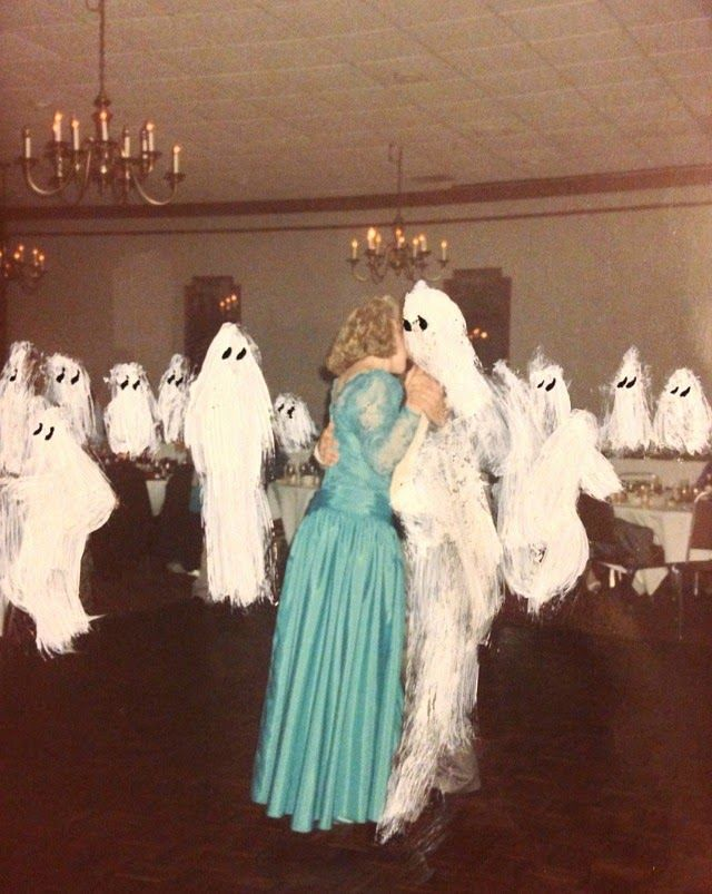 Artist Angela Deane Creates Humorous Ghost Paintings on Found Photographs | Junkculture