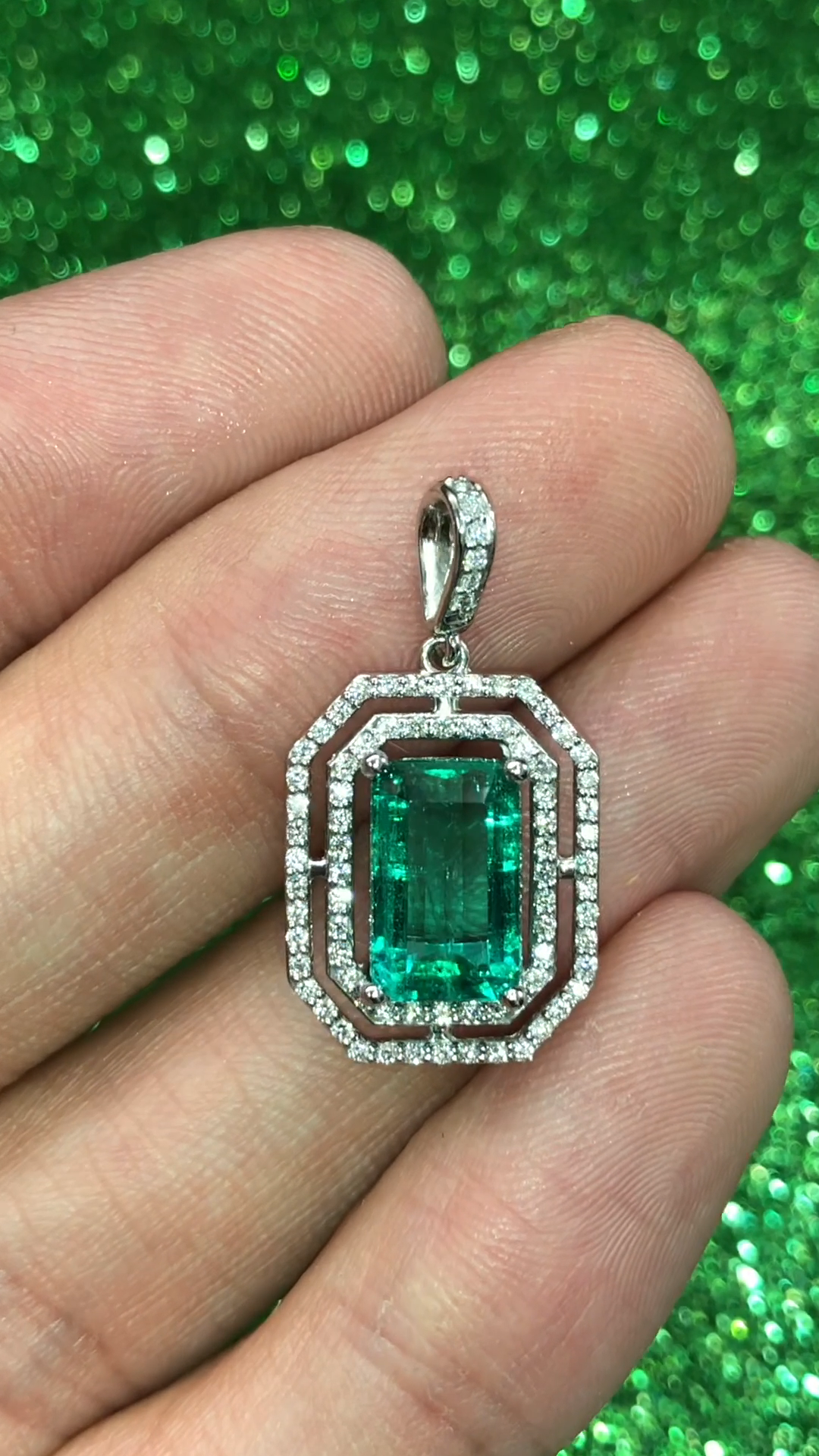 A stunning, vivid, rich green emerald and VS diamond pendant hand set in platinum. This was a customized setting for our elongated 2.69ct Colombian emerald that was selected loose. Simple and elegant, an ideal anniversary piece for my special client 😍 #emerald #emeralds #emeraldcut #emeraldcutdiamond #emeraldcutengagementring #emeraldcutnecklace #colombianemerald #colombianemeralds #looseemerald #loosegemstone #emeraldpendant #emeraldnecklace #halopendant #halonecklace #engagementjewelry