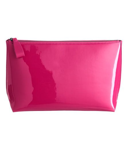Check this out! Spacious toiletry bag in imitation leather with zip at top and two inner compartments. Lined. Size 4 x 7 1/2 x 11 in. - Visit hm.com to see more.