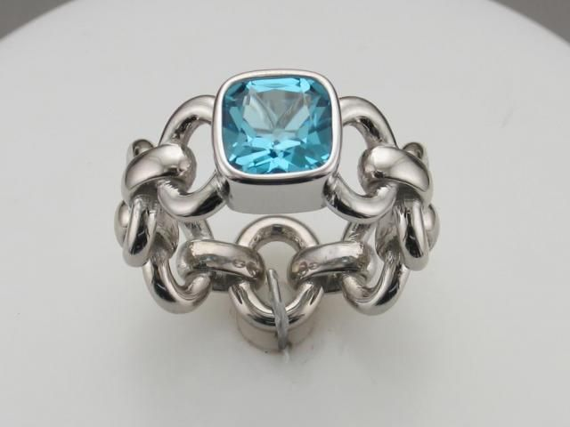 Love the incorporation of chain link in a ring. Not to mention the blue topaz is so vibrant!