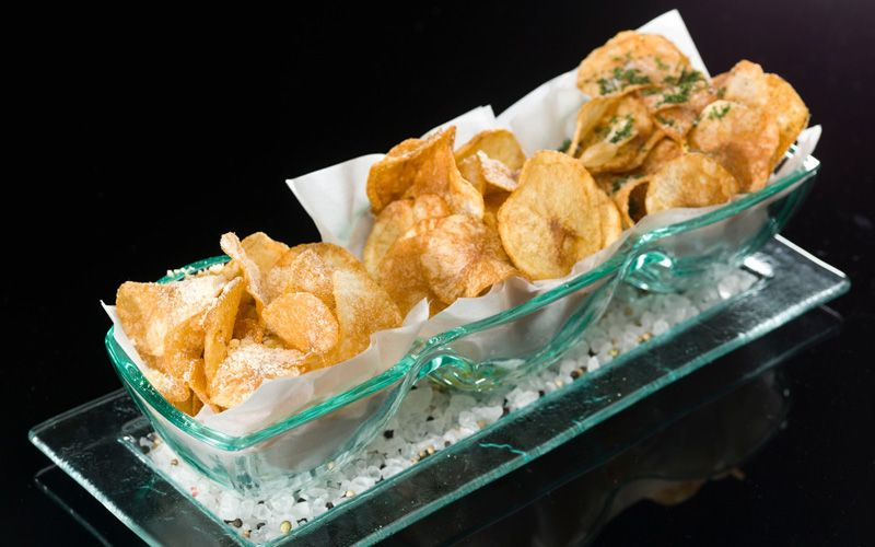 Snack on these gourmet chips at Prelude by Barton G.