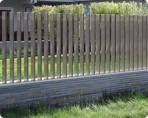 block with stone veneer wall with stainless steel slats make a great fence for the modern - Wall Fencing Designs