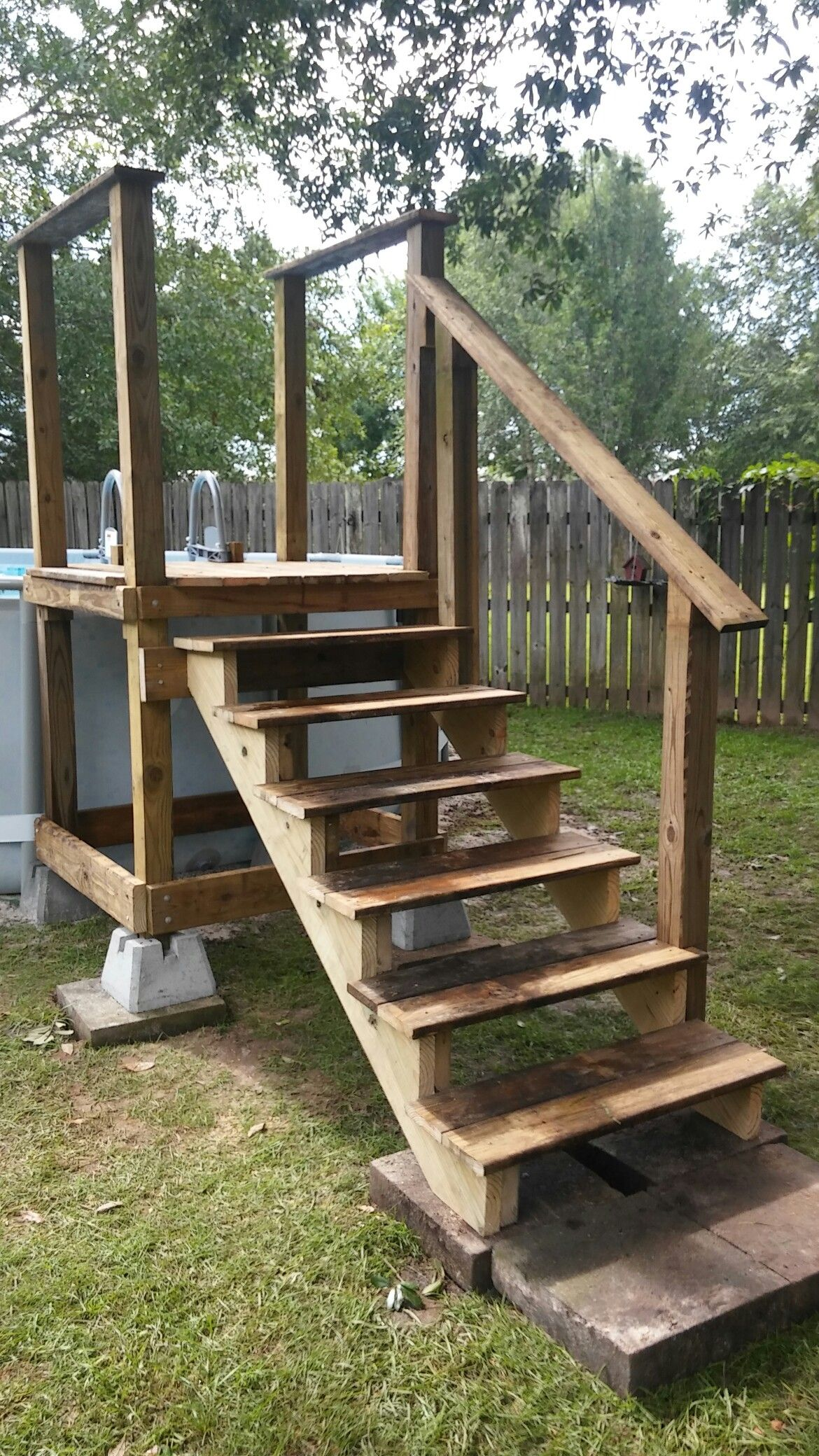 Pool access platform w repurposed pool ladder going into - How to build a swimming pool out of wood ...