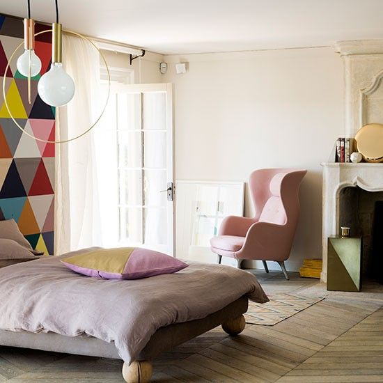 Modern pastel bedroom with geometric feature wall Bedroom