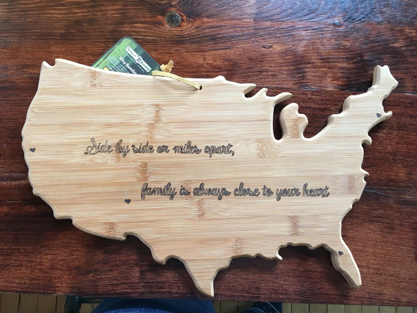 Side by side or miles apart, family is always close to your heart. Personalized cutting board.