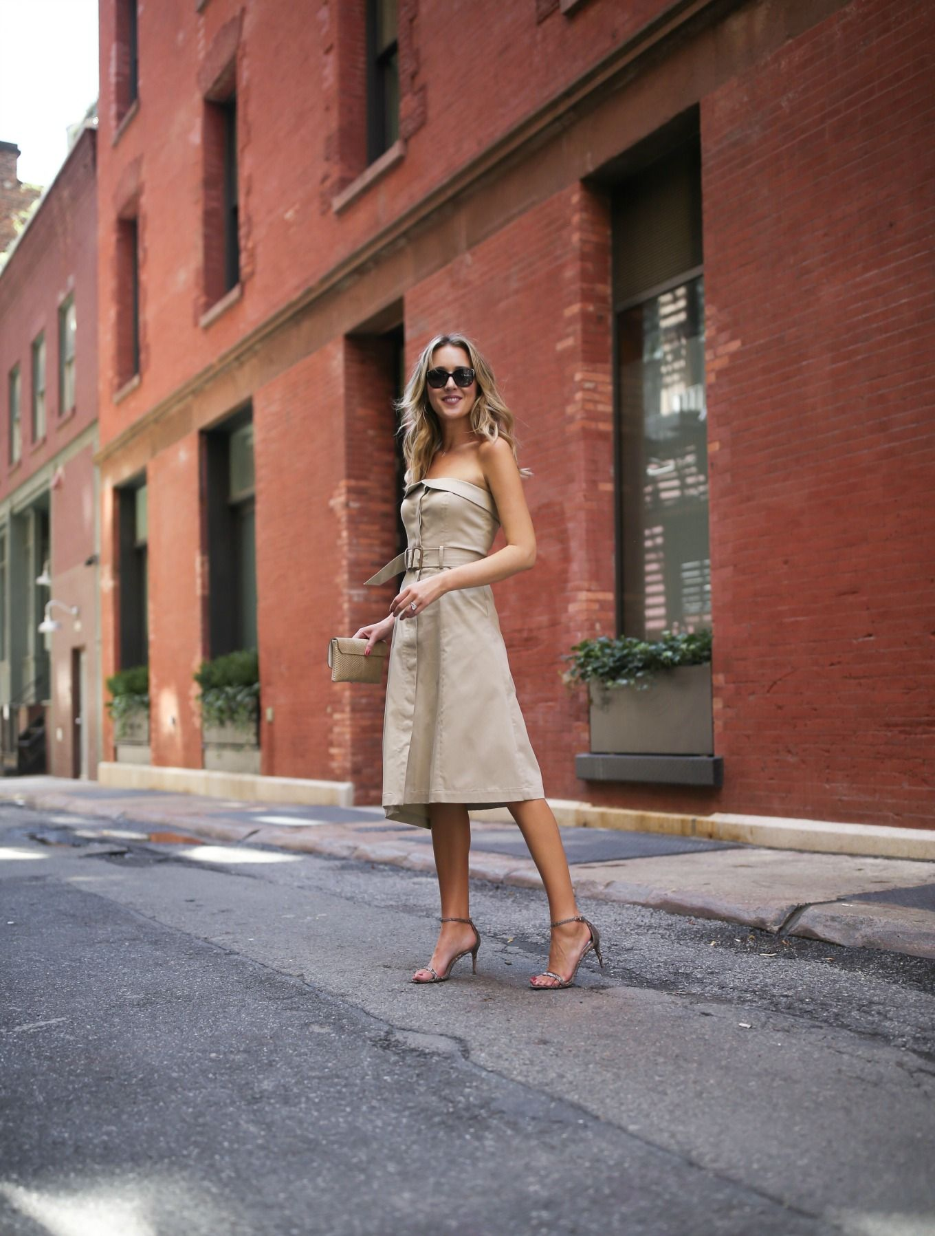 fa99984e30837 Khaki strapless fit and flare Banana Republic dress with nude sandals and a  gold snakeskin clutch