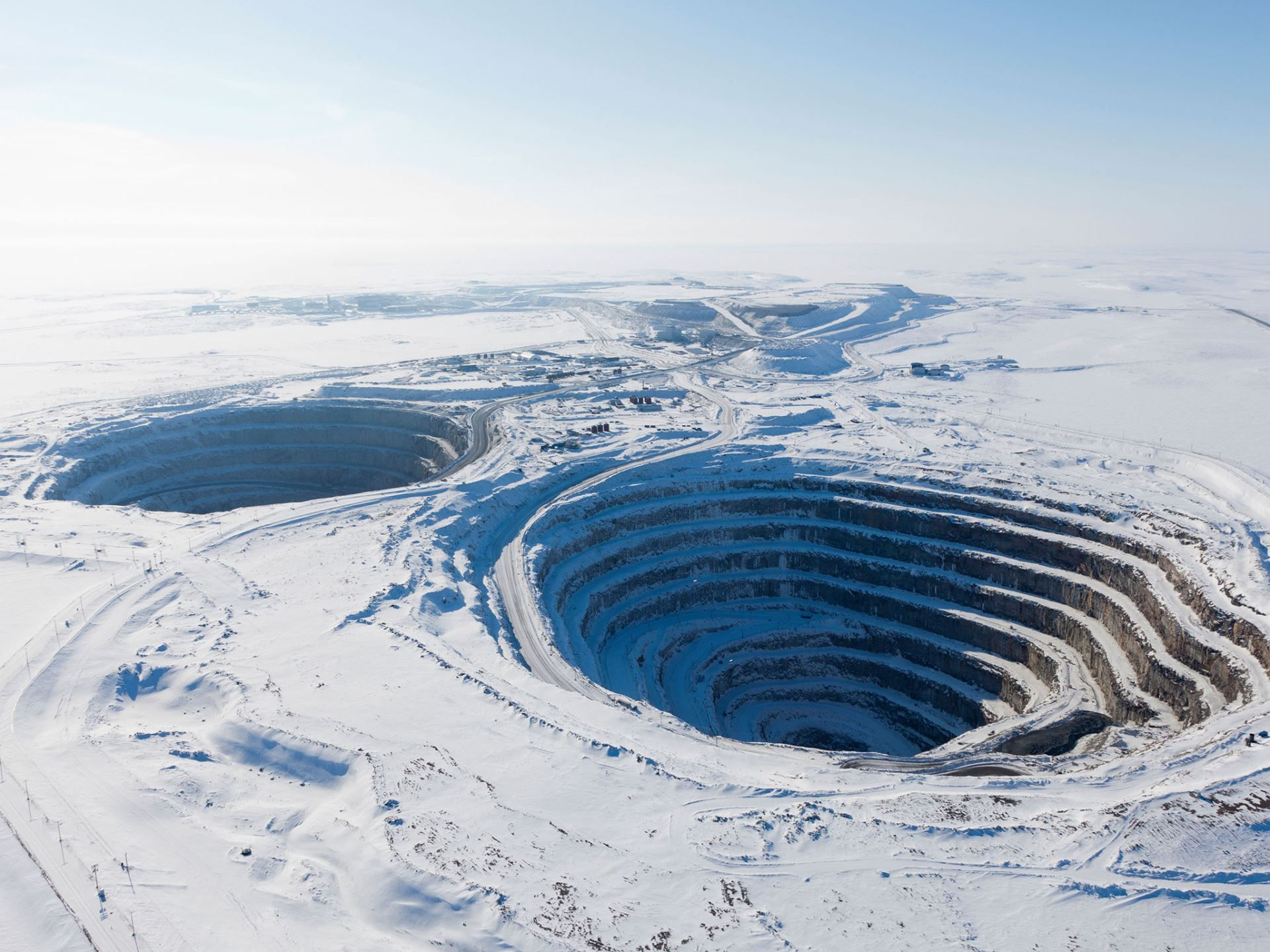 Deepest Holes in the World -  Diavik Diamond Mine, Northwest Territories, Canada On East Island in Lac de Gras in the Canadian Arctic, you'll find the Diavik Diamond Mind, accessible only by local airport and an ice road in permitting weather. The open-pit mine reaches depths of more than 600 feet. The site opened for production in 2003 and delivers 3,300 pounds of diamonds on average annually.