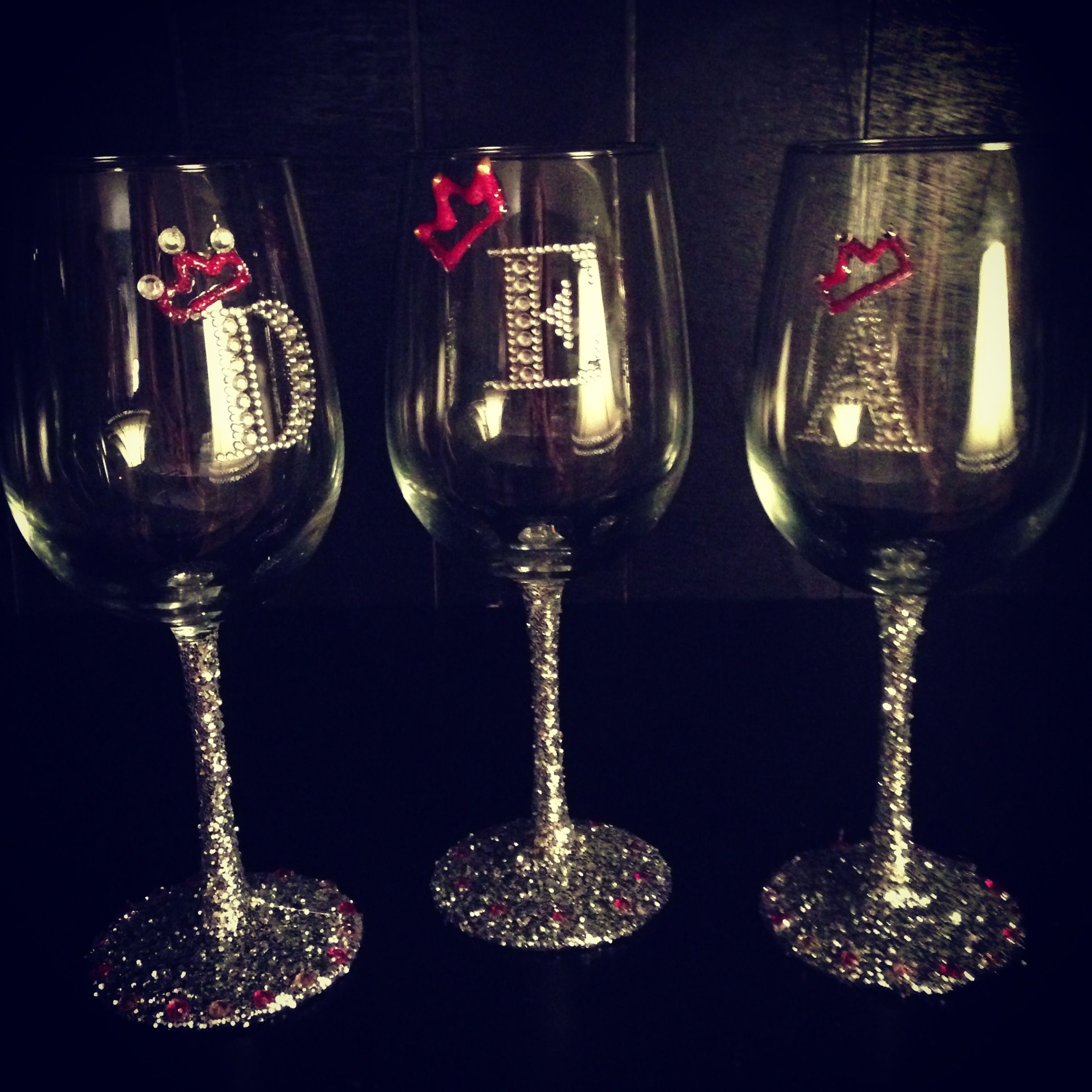 decorated wine glasses with glitter and rhinestones :)We just painted Elmer's glue on the base and stem with a paintbrush, then dipped them in glitter. The letters were pre-made stick ons, and the crowns are puffy paint!