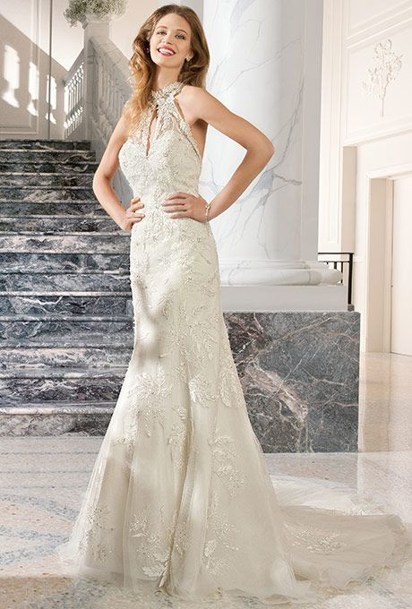 Brides: Demetrios Couture. This beaded lace halter gown features a high beaded illusion neckline with key-hole cut-out and plunging low back with chapel train.