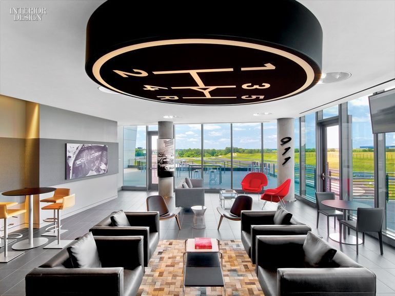 27 Simply Amazing Interiors Transformed by Art   The café welcomes the public with a pair of Eero Saarinen lounge chairs in a corner. #interiordesign #interiordesignmagazine #design #art #installation