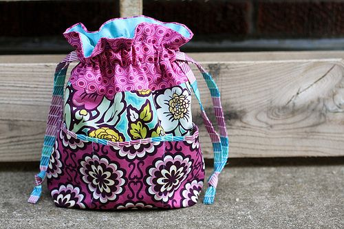 Drawstring bag with outside pockets