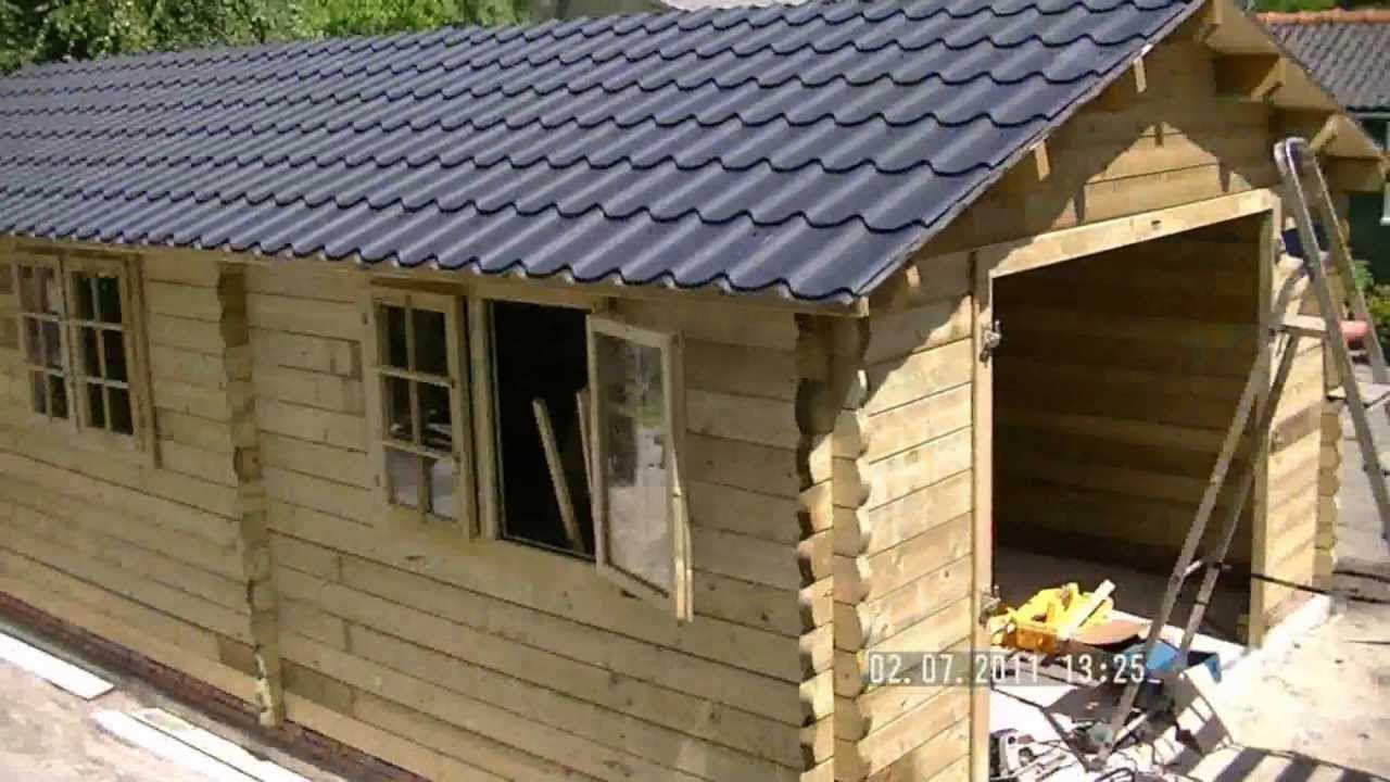 Nieuwsgierig hoe wij een houten garage bouwen? Kijk naar LEUKE film, klik: