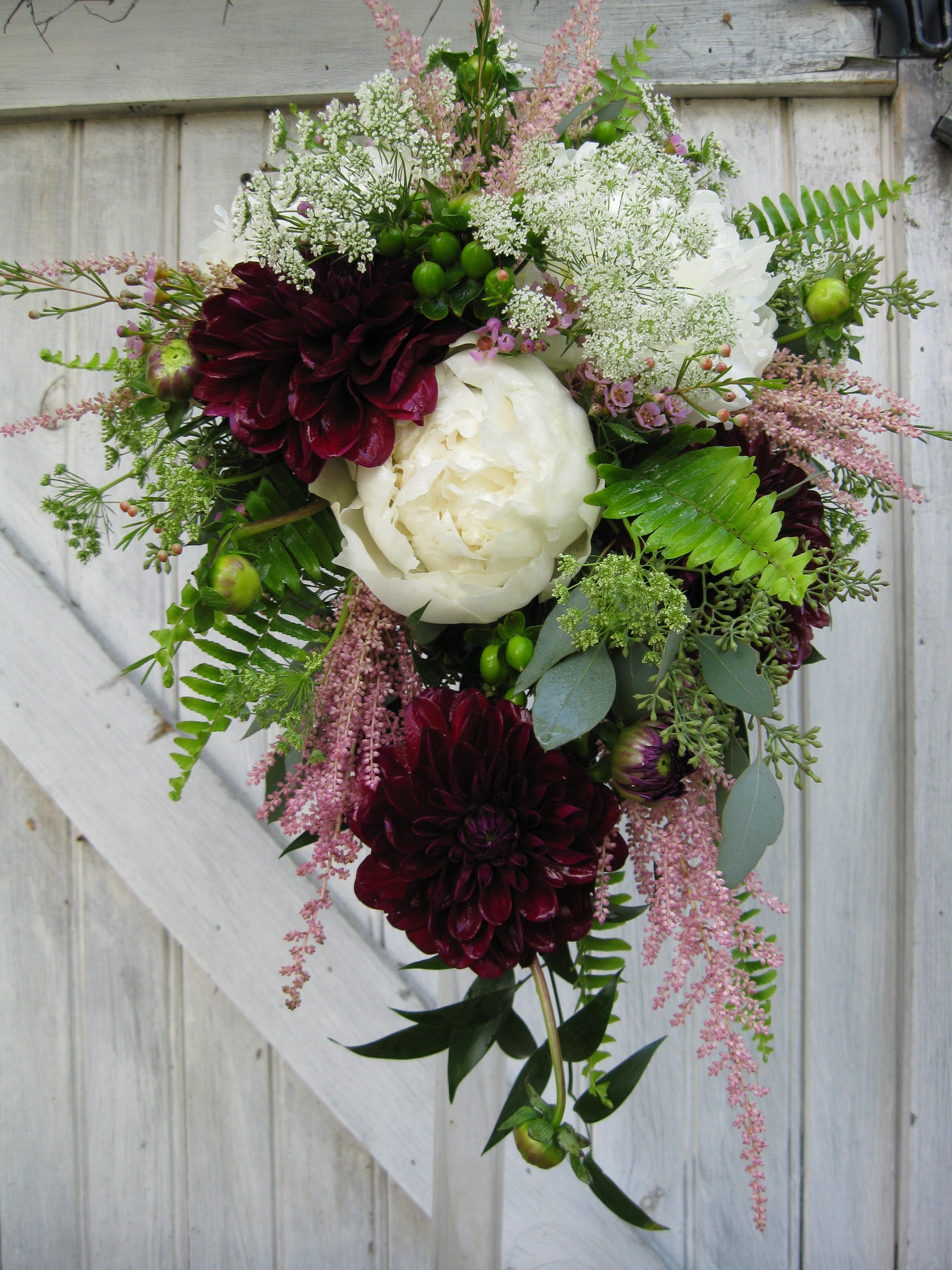 This teardrop bridal bouquet features white peonies
