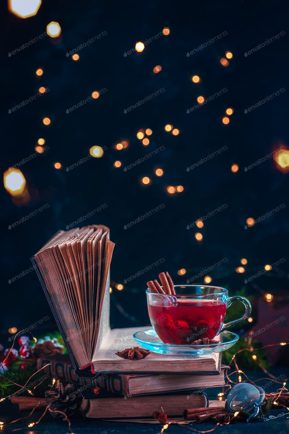 Red Berry Tea On A Stack Of Books With Fairy Lights Christmas Drink On A Dark Backgro Christmas Lights Christmas Light Photography Christmas Lights Background