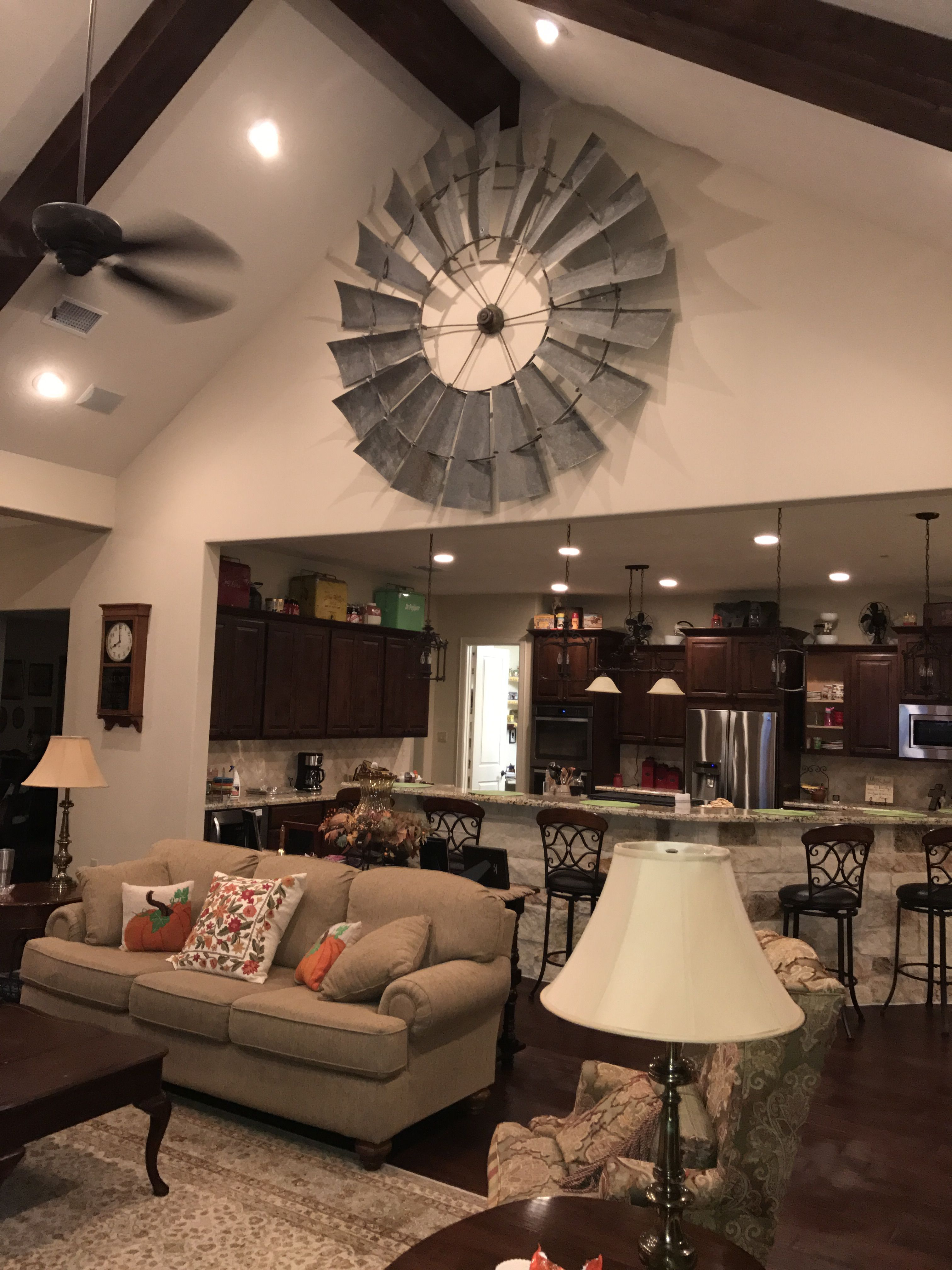 Vintage windmill fan blade added accent to blank wall